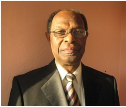 Executive Director Dr. Kenrick Leslie, CBE