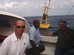 Dr. Leslie (C), Carlos Fuller, 5Cs International  & Regional Liason Officer (R), and High Commissioner Tysoe