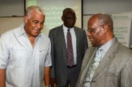 Water, Land, Environment and Climate Change Minister, Robert Pickersgill (left), I discussions with CCCCC Executive Director, Dr. Kenrick Leslie (right) (JIS PHOTO)
