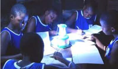 Children using solar lamp to study in a remote village Credit: CARICOM Newsletter