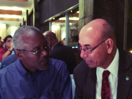 Dr Leonard Nurse (L), Chairman of the Board of Governors, CCCCC, and Carlos Fuller (R), International and Regional Liaison Officer, CCCCC, converse during COP 20
