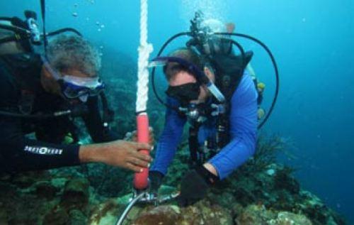 Addison Titus, IMA Marine Technician (l), and Jon Fajans, secure the CREWS buoy