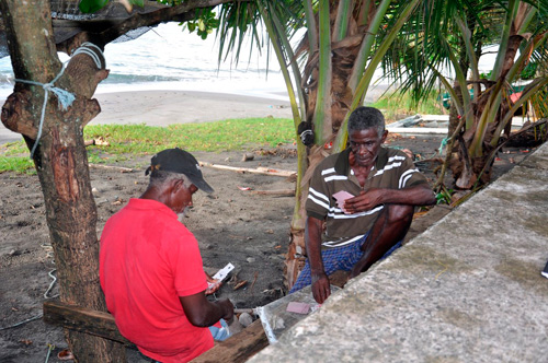 Grenadian fishermen Henry Prince (right) and Ralph Crewney see beachfront living as a virtual birthright, despite the risks posed by climate change.