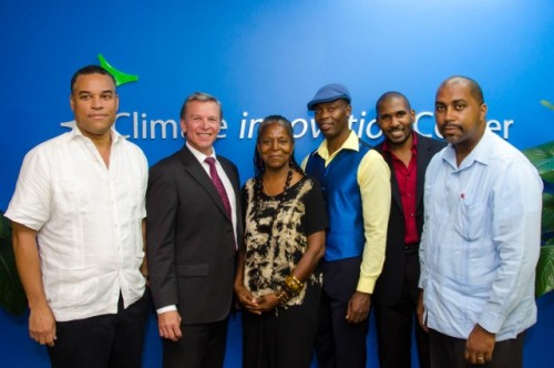 Minister of State in the Ministry of Science, Technology, Energy and Mining, Hon. Julian Robinson (right) and Counsellor and Head, Development Cooperation, at the Canadian High Commission, Walter Bernyck (second left), with grant recipients and innovators (from left): Robert Wright, Shirley Lindo, Harlo Mayne and Dr. Kert Edward, at a cocktail reception to highlight the work of the Caribbean Climate Innovation Centre (CCIC), held at the Scientific Research Council (SRC), in St. Andrew, on September 16.