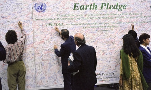People sign the Earth pledge made at the the UN Conference on Environment and Development (UNCED) in June 1992. Photograph: UN Photo