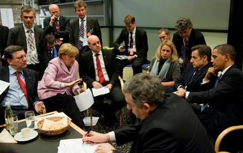 US president Barack Obama along with European leaders including German chancellor Angela Merkel, centre, attend negotiations on the final night of the Copenhagen UN Climate Change summit in Denmark on 18 December 2009. Photograph: Pool/Getty Images