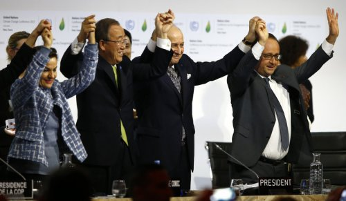 French President Francois Hollande, right, French Foreign Minister and president of the COP21 meetings Laurent Fabius, second right, UN climate chief Christiana Figueres, left, and UN Secretary-General Ban ki-Moon join hands after the final adoption of an agreement at the COP21 United Nations conference on climate change. Francois Mori/AP