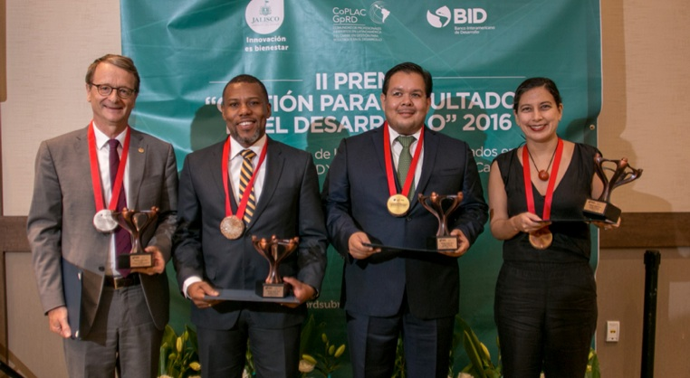 From L-R is Dr. Frederic Martin, Co-President of IDEA and Mr. Ronald Jackson, Executive Director of CDEMA with other awardees.